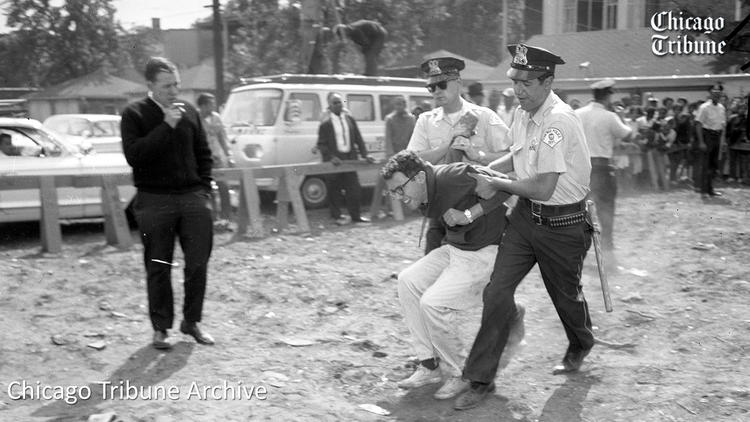 A 21-year-old Bernie Sanders being arrested by the Chicago PD at a civil rights protest in 1963.